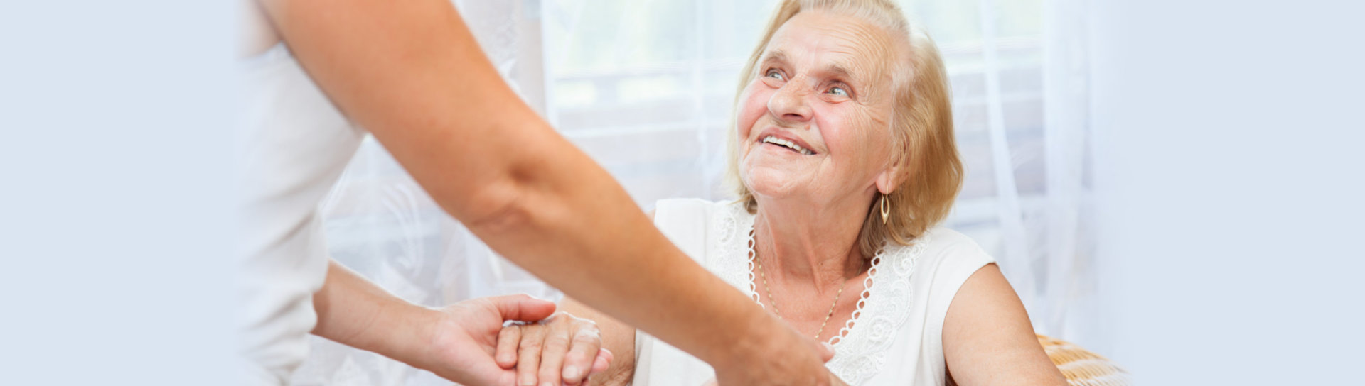 male caregiver with an elderly - home care image